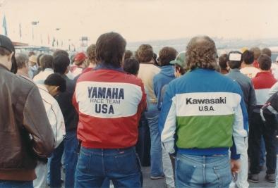 Daytona riders' meeting showing David Graham (Yamaha jacket) and Randy Marrs (Kawasaki jacket).